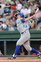 Third baseman Hunter Dozier (13) of the Lexington Legends hits in a game against the Greenville Drive on Friday, August, 16, 2013, at Fluor Field at the West End in Greenville, South Carolina. Dozier was the No. 1 pick (eighth overall) by the Kansas City Royals in the first round of the 2013 First-Year Player Draft. He played collegiate ball for Stephen F. Austin University. Greenville won, 2-1. (Tom Priddy/Four Seam Images)