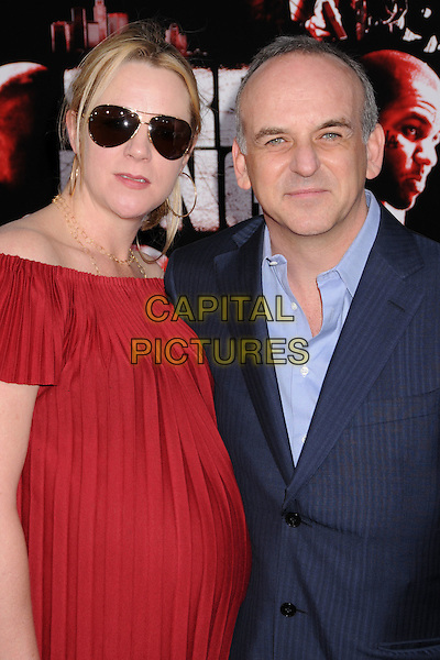 "LUCAS FOSTER (PRODUCER) & GUEST.""Street Kings"" Los Angeles Premiere at Grauman's Chinese Theatre, Hollywood, California, USA..April 3rd, 2008.half length red top pregnant sunglasses shades blue suit jacket .CAP/ADM/BP.©Byron Purvis/AdMedia/Capital Pictures."