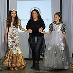Fashion designer Adrianna Ostrowska walks runway with models at the close of her Adrianna Ostrowska fashion show, during the KidFash Magazine runway show in Brooklyn, New York on Nov 4, 2017.