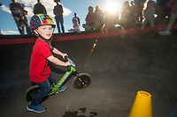 Carson Owen, 3, of Fayetteville races in the age 3-4 category, in which he placed 4th, Wednesday, Oct. 10, 2018, during the Strider Bikes pump track races at The Jones Center's Runway Bike Park in Springdale. Children ages 3-6, divided into two age groups, raced head-to-head to see who was the fastest on the balance bikes designed to help young children learn how to ride. It was the first competetive event to use the new pump track that was built to host the Red Bull Pump Track World Championship Final coming up Saturday.