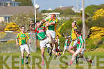 Sean O'Shea for St Michaels Foilmore and Finuge's Maurice Corridan get caught up in an aerial battle with Sean O'Shea emerging the winner on this occasion.
