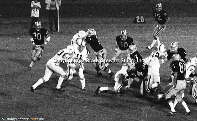 Bethel Park PA:  Offensive play with Bethel running the triple option. Clark Miller 30 running the ball off right guard after good blocks by Dennis Franks 66, Joe Barrett 75 and Don Troup 51, and Bob Hensler 77. Others in the photo; Mike Stewart 11, Gary Biro 81. The offense and defense did not play well in the 12-6 defeat vs Montour. Montour's quarterback, Jim Daniels, killed the Blackhawks.  Jim Daniels was played his college ball at Pitt.  The defensive unit was one of the best in Bethel Park history only allowing a little over 7 points a game.