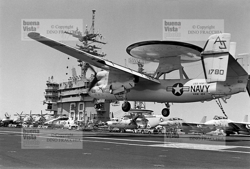 - deck-landing of a E-2C Hawkeye early warning aircraft on Nimitz aircraft carrier....- appontaggio di un aereo da sorveglianza radar E-2C Hawkeye a bordo della portaerei Nimitz..