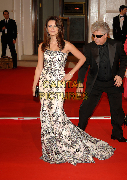 PENELOPE CRUZ.Red Carpet Arrivals at The Orange British Academy Film Awards (BAFTA's) held at the Royal Opera House, Covent Garden, London, England, February 11th 2007..full length strapless black and white patterned dress hand on hip.CAP/PL.©Phil Loftus/Capital Pictures