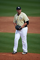 UCF Knights relief pitcher Trent Thompson (42) gets ready to deliver a pitch during a game against the Siena Saints on February 21, 2016 at Jay Bergman Field in Orlando, Florida.  UCF defeated Siena 11-2.  (Mike Janes/Four Seam Images)