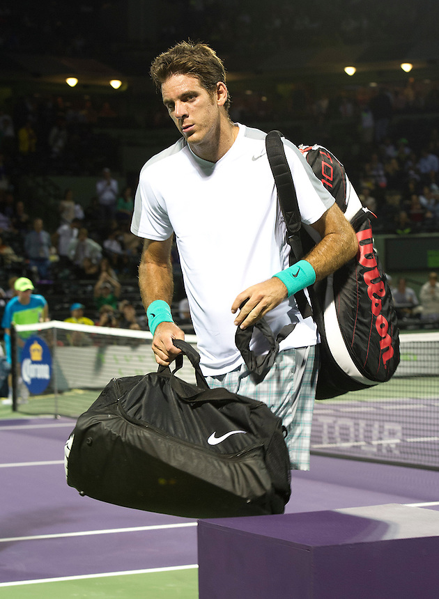A dejected Juan Martin Del Potro (ARG) leaves the court after his defeat by Tobias Kamke (GER) in their ATP Second Round Mens Singles match today - Tobias Kamke (GER) d. [5] Juan Martin Del Potro (ARG) 76(5) 61 (Photos by Andrew Patron)..Tennis - Sony Open Tennis - ATP World Tour Masters 1000 - Tennis Center at Crandon Park Key Biscayne, Miami, Florida USA - Day 5 - Friday 22nd March 2013..© CameraSport - 43 Linden Ave. Countesthorpe. Leicester. England. LE8 5PG - Tel: +44 (0) 116 277 4147 - admin@camerasport.com - www.camerasport.com