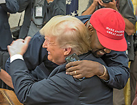 Kanye West hugs United States President Donald J. Trump hugs they meet with Jim Brown in the Oval Office of the White House in Washington, DC on Thursday, October 11, 2018.<br /> Credit: Ron Sachs / CNP /MediaPunch