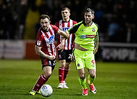 Bolton Wanderers' Daryl Murphy competing with Lincoln City's Neal Eardley (left) <br /> <br /> Photographer Andrew Kearns/CameraSport<br /> <br /> The EFL Sky Bet League One - Lincoln City v Bolton Wanderers - Tuesday 14th January 2020  - LNER Stadium - Lincoln<br /> <br /> World Copyright © 2020 CameraSport. All rights reserved. 43 Linden Ave. Countesthorpe. Leicester. England. LE8 5PG - Tel: +44 (0) 116 277 4147 - admin@camerasport.com - www.camerasport.com
