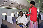 Air Malawi Flight Attendant Interacting With Passenger