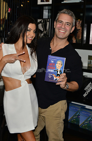 MIAMI, FL - NOVEMBER 06: Andy Cohen and Adriana De Moura pose picture during Andy Cohen book signing of his paperback release 'The Andy Cohen Diaries: A Deep Look at a Shallow Year' at Books and Books At Adrienne Arsht Center on November 6, 2015 in Miami, Florida. Credit: MPI10 / MediaPunch