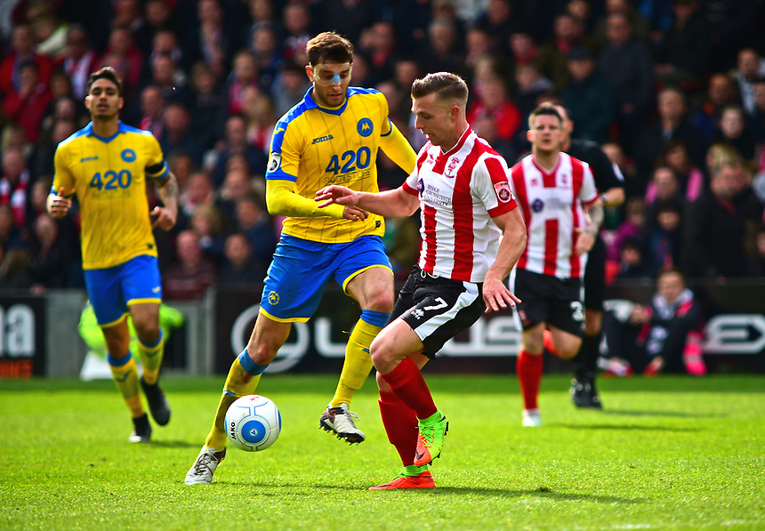 Lincoln City's Jack Muldoon vies for possession with Torquay United's Myles Anderson<br /> <br /> Photographer Andrew Vaughan/CameraSport<br /> <br /> Vanarama National League - Lincoln City v Chester - Tuesday 11th April 2017 - Sincil Bank - Lincoln<br /> <br /> World Copyright &copy; 2017 CameraSport. All rights reserved. 43 Linden Ave. Countesthorpe. Leicester. England. LE8 5PG - Tel: +44 (0) 116 277 4147 - admin@camerasport.com - www.camerasport.com