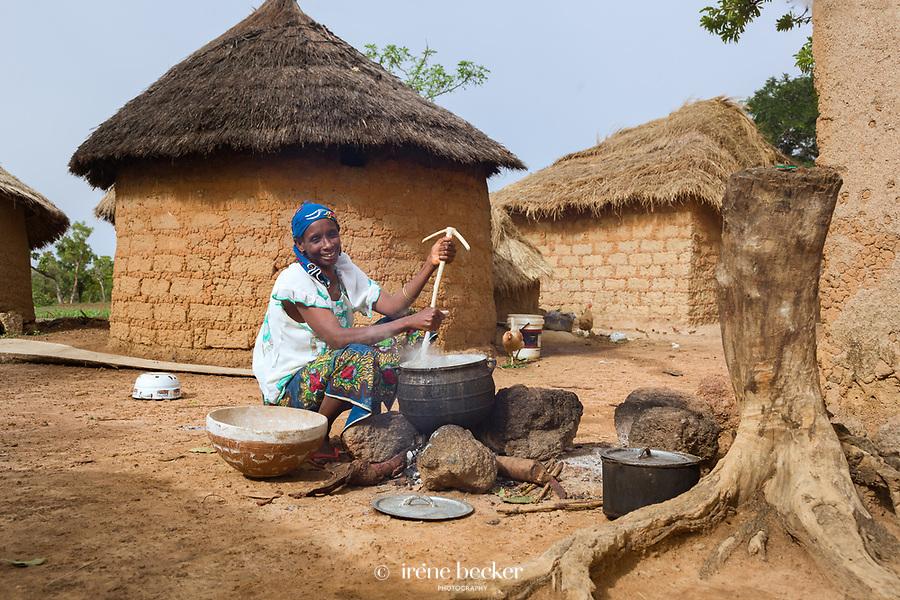 Cooking fulani woman. Kajuru,  North-western Nigeria.