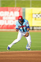 Tennessee Smokies shortstop Addison Russell (4) bobbles a ground ball during the game against the Mississippi Braves at Smokies Park on July 22, 2014 in Kodak, Tennessee.  The Smokies defeated the Braves 8-7 in 10 innings. (Brian Westerholt/Four Seam Images)