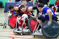 15 AUG 2011 - LEEDS, GBR - Canada's Fabien Lavoie (number 11) attempts to avoid a challenge from Great Britain's Ross Morrison (right) during the wheelchair rugby exhibition match between the two teams (PHOTO (C) NIGEL FARROW)