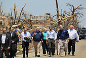 (L - R) Administrator of the Federal Emergency Management Agency, William Fugate, United States President Barack Obama and Missouri Governor Jay Nixon walk together during a visit to the community that was devastated a week ago by a tornado on May 29, 2011 in Joplin, Missouri. The tornado, which was packing winds of more than 200 mph, is now considered to hold the record for the highest death toll in U.S. history.  (Photo by Joe Raedle/Getty Images).Credit: Joe Raedle / Pool via CNP