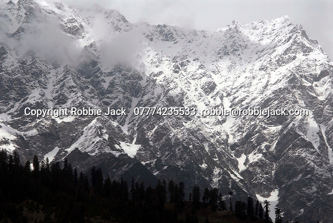 The original name for the Kullu valley was Kulantapith -the end of the habitable world.It is a narrow alpine valley drained by the Beas River and enclosed by the Pir Panjal to the north,the Bara Bangahal range to the west and the Parvati range to the east.This view is looking north fromVashisht  towards the Solang Valley and the Rohtang Pass. .