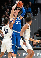 WASHINGTON, DC - FEBRUARY 05: Sandro Mamukelashvili #23 of Seton Hall holds the ball away from Terrell Allen #12 of Georgetown during a game between Seton Hall and Georgetown at Capital One Arena on February 05, 2020 in Washington, DC.