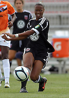 BOYDS, MARYLAND - July 22, 2012:  Maddy Brown (4) of DC United Women makes a pass against the Charlotte Lady Eagles during the W League Eastern Conference Championship match at Maryland Soccerplex, in Boyds, Maryland on July 22. DC United Women won 3-0.