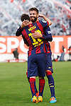 Barcelona´s Leo Messi celebrates a goal with Pique during La Liga match between Rayo Vallecano and Barcelona at Vallecas stadium in Madrid, Spain. October 04, 2014. (ALTERPHOTOS/Victor Blanco)
