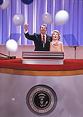 United States President Ronald Reagan and first lady Nancy Reagan watch balloons fall on the podium of the 1988 Republican Convention as they acknowledge their supporters at the Super Dome in New Orleans, Louisiana on August 15, 1988.<br /> Credit: Arnie Sachs / CNP