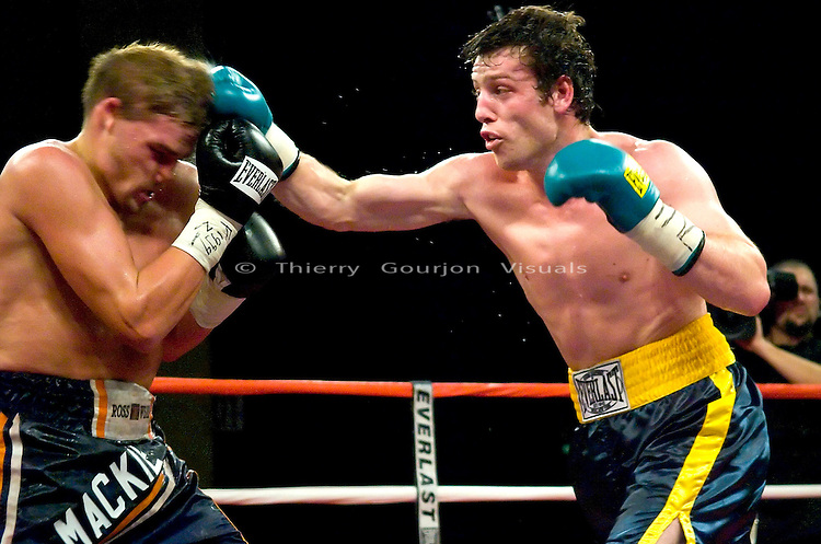 John Duddy  (green and yellow) on the attack against Bryon Mackie during their 8 Rounds Middleweight fight at the Hammerstein Ballroom in New York, NY on 11.04.05. Duddy won by TKO in the 4th round.
