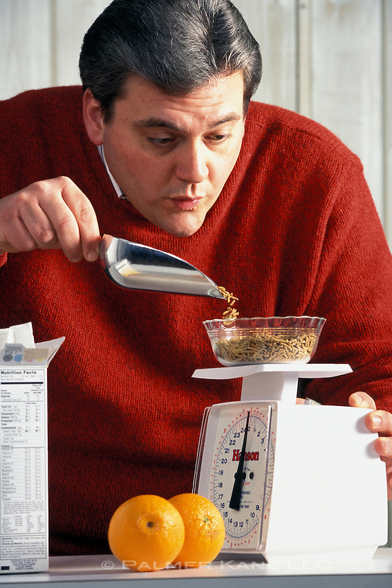 Man weighing out dietetic meal