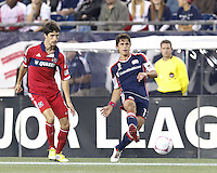 New England Revolution defender Ryan Guy (13) passes the ball as Chicago Fire midfielder Alvaro Fernandez (4) closes. In a Major League Soccer (MLS) match, the New England Revolution defeated Chicago Fire, 1-0, at Gillette Stadium on October 20, 2012.