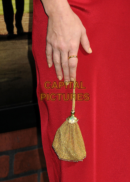 "Amy Adams' bag.""Trouble With The Curve"" Los Angeles Premiere held at the Regency Village Theatre, Westwood, California, USA..September 19th, 2012.gold ring detail red nude nail varnish polish.CAP/ADM/BP.©Byron Purvis/AdMedia/Capital Pictures."