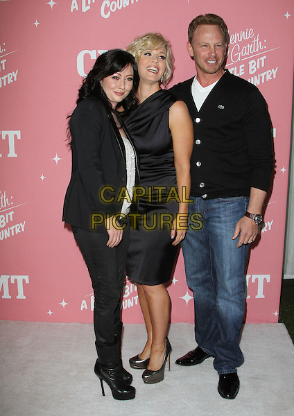 "Shannen Doherty, Jennie Garth, Ian Ziering.Jennie Garth's 40th Birthday Celebration & Premiere Party For ""Jennie Garth: A Little Bit Country"" Held at The London Hotel, West Hollywood, California, USA..April 19th, 2012.full length black white jacket blazer top jeans denim boots one shoulder dress cardigan jeans denim.CAP/ADM/KB.©Kevan Brooks/AdMedia/Capital Pictures."