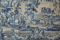 Hunting scene with men spearing deer, traditional blue and white azulejos tile scene, 18th century, part of a series depicting the history of the monastery and the Siege of Lisbon in 1147, in the Monastery of Sao Vicente de Fora, an Augustinian order monastery and church built in the 17th century in Mannerist style, Lisbon, Portugal. The monastery also contains the royal pantheon of the Braganza monarchs of Portugal. Picture by Manuel Cohen