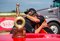 Jun 9, 2019; Topeka, KS, USA; NHRA pro mod driver Steve Jackson celebrates with his crew chief after winning the Heartland Nationals at Heartland Motorsports Park. Mandatory Credit: Mark J. Rebilas-USA TODAY Sports