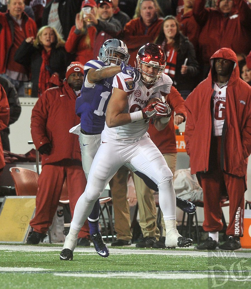 NWA Democrat-Gazette/MICHAEL WOODS • @NWAMICHAELW<br /> University of Arkansas tight end Arkansas tight end Hunter Henry (84) makes a catch in front of Kansas defender Donnie Starks (10) in the 4th quarter of the Razorbacks 45-23 win over Kansas State in the 57th annual AutoZone Liberty Bowl January 2, 2016.