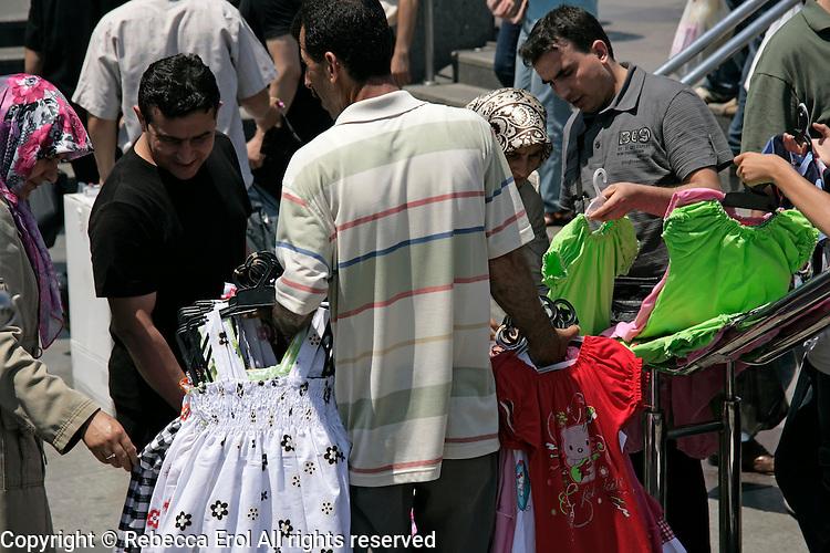 Selling dresses on the streets of Eminonu, Istanbul, Turkey