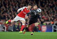 Laurent Koscielny of Arsenal and Robert Lewandowski of Bayern Munich during the UEFA Champions League round of 16 match between Arsenal and Bayern Munich at the Emirates Stadium, London, England on 7 March 2017. Photo by Alan  Stanford / PRiME Media Images.