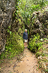 A tourist on the path by the Magic Waterfalls or Cascadas Magicas in the Sierra Madre Mountains near Huatulco, Mexico.