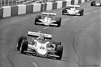 HAMPTON, GA - APRIL 22: Gordon Johncock (#20 Penske PC6/Cosworth TC) leads Johnny Rutherford (#4 McLaren M24B/Cosworth TC) and others during the Gould Twin Dixie 125 event on April 22, 1979, at Atlanta International Raceway near Hampton, Georgia.