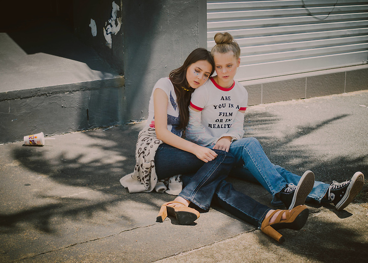 """""""The Day After"""" photoshoot with young Brisbane sisters Laura (blonde) of Busy Models  and older sister Julia Yeap (brunette) in Brisbane, Queensland, Australia, Sunday, February 21, 2016. Julia wear top from Pepe jeans London, Leopard print knit from Peter Alexander, jeans from Burberry and Tony Bianco shoes and Ra Ra Super Star choker. Laura wears – Shirt and jeans from Levis, t-shirt from Pepe jeans London with Converse sneakers.  (Photo by John Pryke, Styling - Sandra Carvalho, MUA - Teena Jade - Make Up Artist)"""