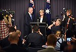 Malcolm Turnbull, (L) Australia's incoming prime minister, watches Foreign Minister Julie Bishop (R) speak during a news conference after winning a party leadership ballot in Canberra, Australia, on Monday, Sept. 14, 2015. Photographer: Mark Graham/Bloomberg *** Local Caption *** Malcolm Turnbull