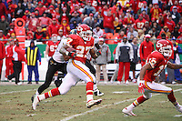Chiefs running back Larry Johnson picks up 40 yards on this play in the second quarter against the Jacksonville Jaguars at Arrowhead Stadium in Kansas City, Missouri on December 31, 2006. Kansas City won 35-30.