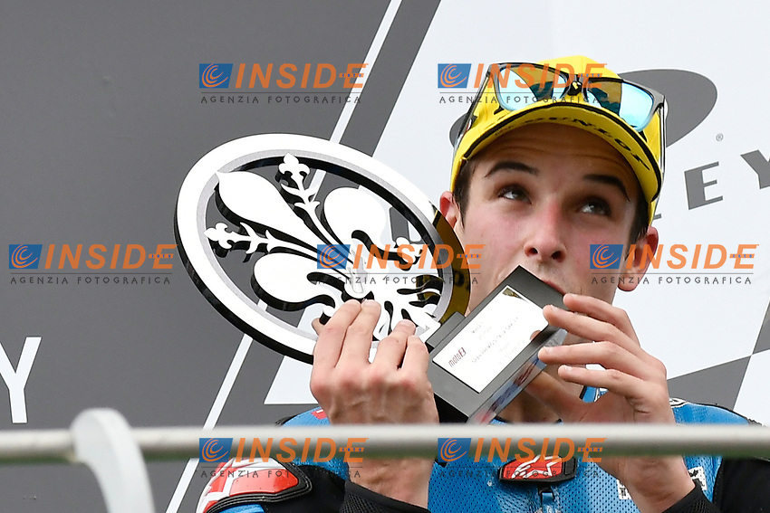 SCARPERIA,FLORENCE, ITALY - JUNE 04:,2017 Mattia Pasini of Spain and EG 0,0 Marc VDS (Moto2) celebrates on the podium his third place at the end race MotoGP during  MotoGP Gran Premio d'Italia- at Mugello Circuit. on june 04, 2017 in Scarperia Italy.<br /> Photo Marco Iorio/Insidefoto