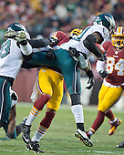 Philadelphia Eagles kick-off returner Josh Huff (11) is tackled by Washington Redskins cornerback Bashaud Breeland (26) in first quarter action at FedEx Field in Landover, Maryland on Saturday, December 20, 2014.<br /> Credit: Ron Sachs / CNP