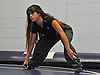 Lisauri Almanzar, a junior and varsity wrestler at Amityville High School stretches at the start of wrestling practice at Copiague High School on Tuesday, Jan. 31, 2017.