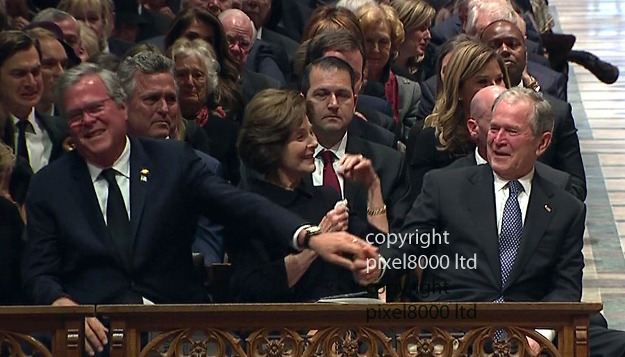 George Bush Funeral was<br /> <br /> Son George W Bush breaks down at the end of his speech and consoled by wife Laura and brother Jeb on return to his seat<br /> <br /> <br /> <br /> attended by living Presidents of the USA<br /> President Trump<br /> with former Presidents Obama Clinton and Carter<br /> with First Ladies Melania  Michelle and Hillary<br /> <br /> Trumps and Clintons pointedly ignored each other.<br /> But Trumps shook hands with Obamas and George W Bush and his wife Barbara<br /> <br /> <br /> <br /> Picture by Pixel8000 07917221968
