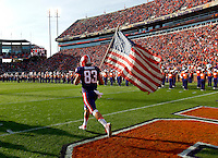 Clemson wide receiver Daniel Rodriguez (83) leads the team onto the field to face Georgia State on Saturday. Rodriguez, a decorated combat veteran, was also honored for senior day.