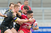 Picture by Allan McKenzie/SWpix.com - 07/04/2018 - Rugby League - Betfred Super League - Salford Red Devils v Warrington Wolves - AJ Bell Stadium, Salford, England - Salford's Derrell Olpherts is tackled by Warrington's Jack Hughes and Joe Philbin.