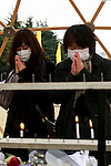 People pray during the fifth anniversary of the Great East Japan Earthquake and Tsunami disaster at the Peace on Earth memorial ceremony in Hibiya Park on March 11, 2016, Tokyo, Japan. Almost 19,000 people lost their lives as a result of the magnitude 9.0 earthquake and subsequent tsunami that hit Japan's north east coast 5 years ago. Five years after the event some 174,000 survivors are still in temporary accommodation. This includes nearly 100,000 from Fukushima who have not been able to return home as a result of the effects of the tsunami and nuclear catastrophe that ensued. (Photo by Rodrigo Reyes Marin/AFLO)