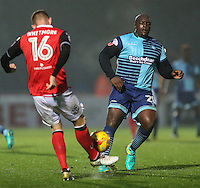 Alex Whitmore of Morceambe and Adebayo Akinfenwa of Wycombe Wanderers challenge for the ball during the Sky Bet League 2 match between Wycombe Wanderers and Morecambe at Adams Park, High Wycombe, England on 12 November 2016. Photo by David Horn.