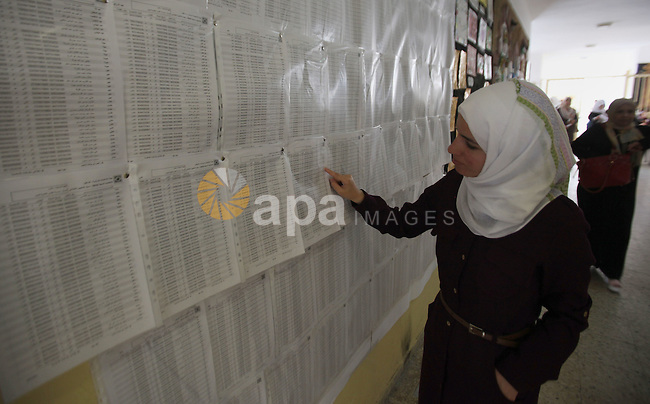 A Palestinian woman looks for her name on the registered voters' list at Voter registration centers in the West Bank city of Nablus on July 24, 2016. The Palestinian Central Elections Commission (CEO) announced Saturday that voter registration centers would be open from Saturday until Wednesday in all local and municipal councils across the occupied West Bank and Gaza Strip in preparations for the upcoming local elections in October. Photo by Nedal Eshtayah