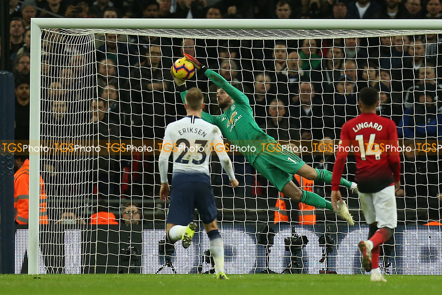 David De Gea of Manchester United saves from Christian Eriksen of Tottenham Hotspur during Tottenham Hotspur vs Manchester United, Premier League Football at Wembley Stadium on 13th January 2019