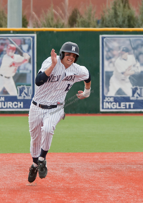 March 30, 2012:   Nevada Wolf Pack's Garrett Yrigoyen heads to third against the BYU Cougars during their NCAA baseball game played at Peccole Park on Friday afternoon in Reno, Nevada.